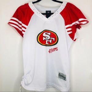 Rebook women's 49ers jersey ( Aprox medium size )